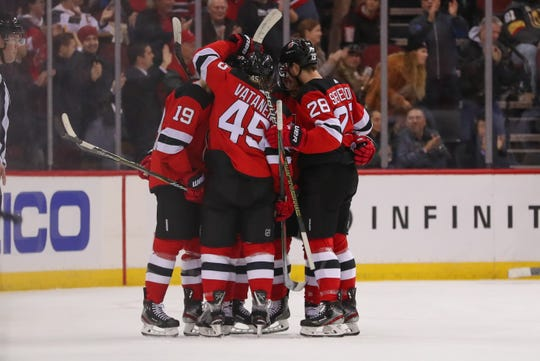The New Jersey Devils celebrate a goal by New Jersey Devils center Kyle Palmieri (21) during the first period of their game against the Vegas Golden Knights at Prudential Center.
