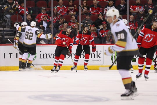 The Vegas Golden Knights celebrate a goal by Vegas Golden Knights center Chandler Stephenson (left) during the second period of their game against the New Jersey Devils at Prudential Center.