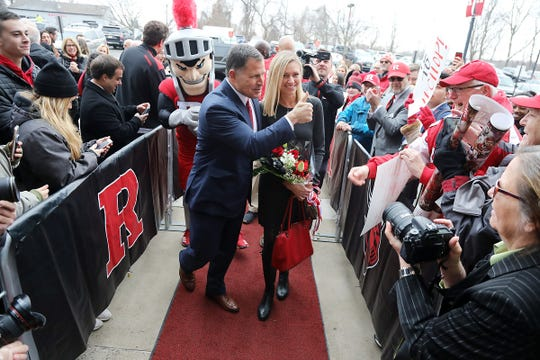 Greg Schiano enters the Hale Center with his wife Christy to be introduced for his second tour as Rutgers head football coach on December 4, 2019 at the Hale Center on Rutgers campus in Piscataway, NJ.