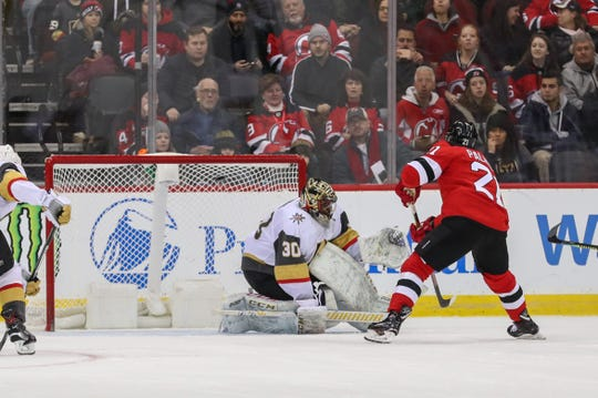 New Jersey Devils center Kyle Palmieri (21) scores a goal on Vegas Golden Knights goaltender Malcolm Subban (30) during the first period at Prudential Center.