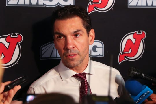 New Jersey Devils interim head coach Alain Nasreddine  speaks to the media prior to the start of a game between the New Jersey Devils and the Vegas Golden Knights at Prudential Center.