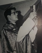 Father Tom Ivory celebrating Mass at St. Dominic Academy in 1964