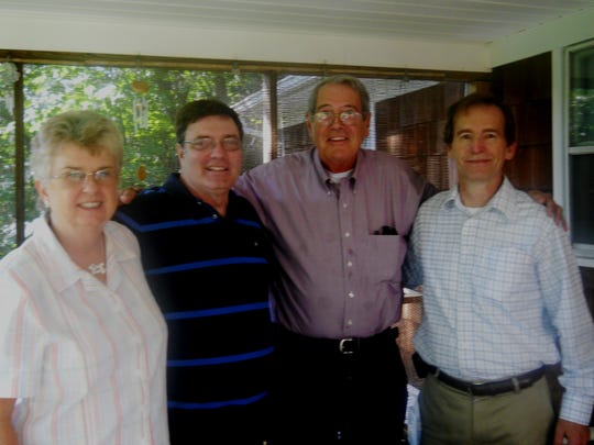 Rosemary Gleeson, Geoerge Peterson, Father Tom Ivory and Bob Larkin at one of their reunions