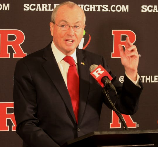Governor Phil Murphy talks before Greg Schiano is introduced for his second tour as Rutgers head football coach on December 4, 2019 at the Hale Center on Rutgers campus in Piscataway, NJ.
