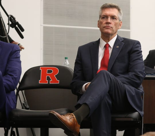 Rutgers Athletic Director Pat Hobbs as listens to Greg Schiano talk during his introduction ushering in his second tour as Rutgers head football coach on December 4, 2019 at the Hale Center on Rutgers campus in Piscataway, NJ.