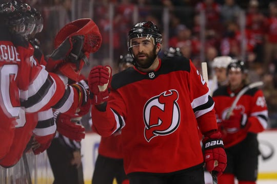 New Jersey Devils center Kyle Palmieri (21) celebrates his goal during the first period of their game against the Vegas Golden Knights at Prudential Center.