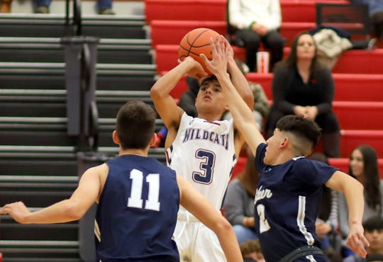 Ramiro Saenz (3) helped guide the Wildcats to their first basketball win Tuesday night at Deming High. Saenz pumped in a game-high 19 points to lead the 'Cats over the Silver High Fighting Colts 72-45.