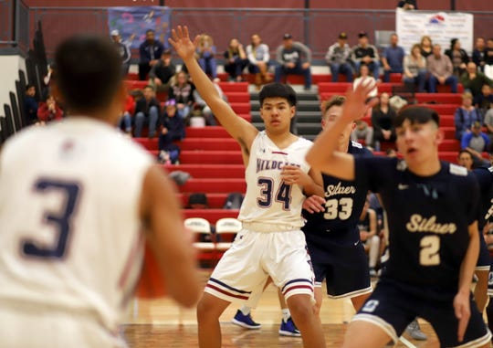 Junior Wildcat Christian Pacheco (34) worked the blocks in the low post for a game-high 19 points and 12 rebounds.