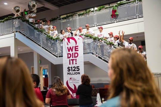 The NMSU Roadrunner Revue, along with NMSU Foundation employees and NMSU dignitaries, celebrate the $125 million Ignite Aggie Discovery campaign at the closing of the 2019 Giving Tuesday event at Corbett Center Student Union on Dec. 3, 2019.