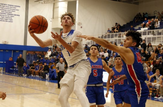 Carlsbad's Josh Sillas gets a contested layup against El Paso Americas on Dec. 3, 2019. Sillas finished with 24 points and Carlsbad won, 59-51.