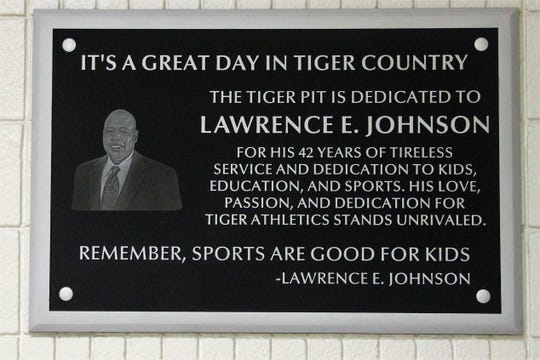 The Alamogordo High School gym, known as the Tiger Pit, was named in honor of the late Coach Lawrence E. Johnson at a ceremony on Dec. 3.