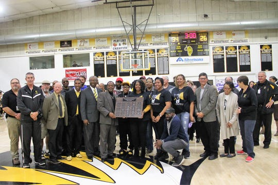 The Johnson Family and Alamogordo Public Schools District staff during a ceremony to rename the Tiger Pit after Lawrence E. Johnson.  The Alamogordo High School gym, known as the Tiger Pit, was named in honor of the late Coach Lawrence E. Johnson at a ceremony on Dec. 3.