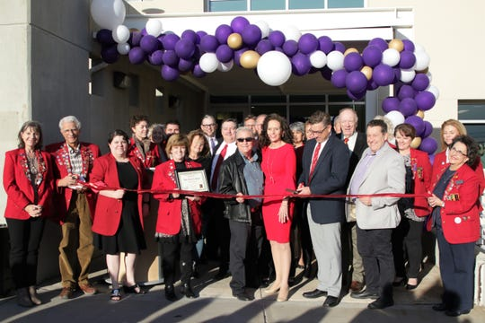 San Juan College President Toni Hopper Pendergrass, center, stands with members of the San Juan College Board of Trustees and members of the Farmington Chamber of Commerce Redcoats as they prepare to open the 30th Street Education Center in Farmington on Dec. 3, 2019.