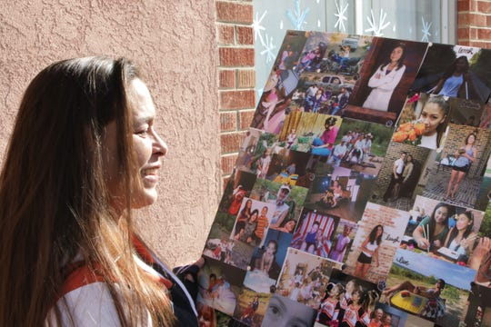 Jamie Lattin looks at a collage of pictures of her daughter, Aztec High School shooting victim Casey Jordan Marquez, in Farmington on Tuesday Dec. 3, 2019.