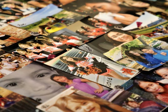 A collage of pictures of Aztec High School shooting victim Casey Jordan Marquez are displayed, Tuesday, Dec. 3, 2019, in Farmington.