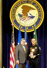U.S. Attorney William Barr stands with Jesse Guardiola of Ruidoso and Tulsa, Okla. after the award.