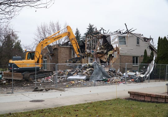 A home at 500 Merion Drive in Canton is finally torn down by bulldozer on Dec. 4, 2019. The home had been severely damaged by fire on Oct. 23, 2018, and had stood empty and fenced off since then.