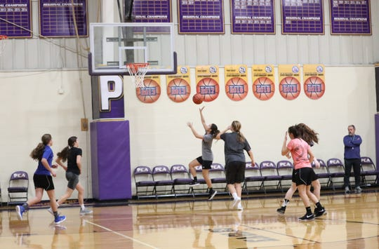 The Plymouth Christian girls basketball team practices near the start of the 2019-20 season.
