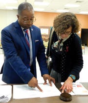 St. Landry Parish School Superintendent Patrick Jenkins and Board President Mary Ellen Donatto review the scoring used on Jenkins' annual performance evaluation that was conducted by board members on Tuesday night.