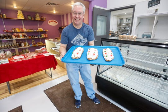 Fishy's Bakery co-owner Bill Laufer holds a tray of Old World Traditional Stollen Wednesday, December 4, 2019 at Fishy's Bakery in Fond du Lac, Wis.