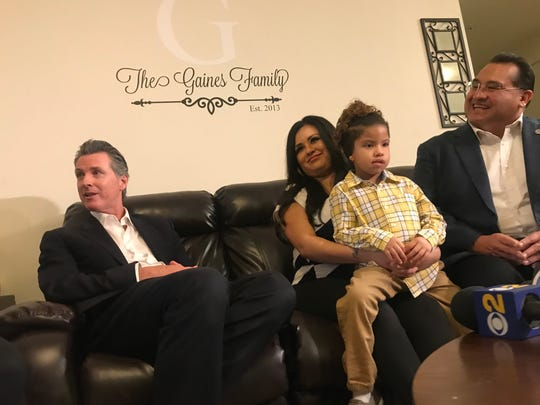 California Gov. Gavin Newsom and Assemblyman James Ramos meet with Yesenia Gaines and her son Jayden to talk about their family's life in the Loma Linda Veteran Village, which are subsidized affordable housing units for homeless veterans.