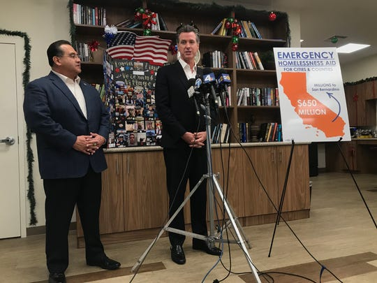 California Gov. Gavin Newsom announces the distribution of $650 million across the state to address homelessness, along with Assemblyman James Ramos, a Democrat representing the state's 40th District.