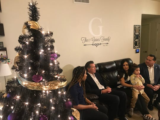 Gov. Gavin Newsom and Assemblymember James Ramos meet with Yesenia Gaines and her son Jayden to talk about their family's life in the Loma Linda Veteran Village, which are subsidized affordable housing units for homeless veterans.