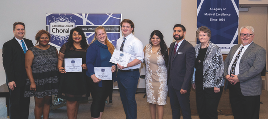 Bruce Mangum proudly shows off scholarship competition winners Jessica Schuler, Jazmin Chavez, Amy Futterman, Tommy Pahl, Rebecca Rodriguez and Javier Contreras along with co-founder Nancy Williams and Artistic Director Tim Bruneau.
