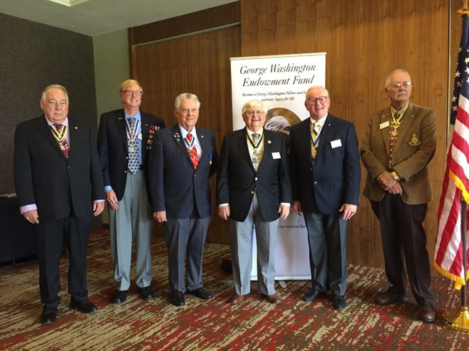 Duane W. Wheeler, Brian R. Stephens, Robert L. Taylor, Larry J. Magerkurth, William M. Haines and James C. Fosdyck celebrate 25 years of the local Sons of the American Revolution chapter.