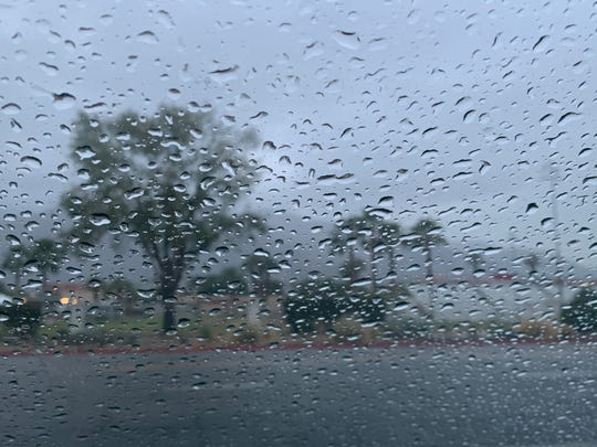 Rain covers a windshield in Palm Springs on Wednesday, Dec. 4, 2019. A trace of rain fell overnight and nearly a half inch was expected through Thursday.