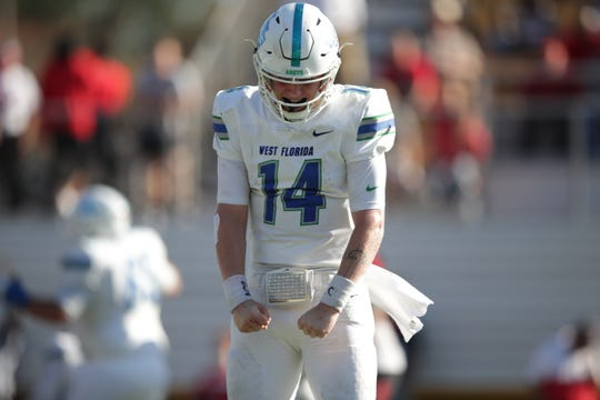 UWF redshirt freshman quarterback Austin Reed celebrates a touchdown scored in the Argos' 38-35 win over Valdosta State on Nov. 30, 2019.