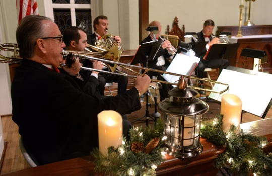 Members of the Perdido Brass perform in 2013 at Old Christ Church during Tidings of Comfort and Joy presented by WUWF Public Media.