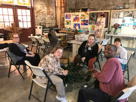 Marlo Sell, middle, and Liz Shearer, left, bring members of Jessica and Friends Community to the Little Art Bank on Tuesday, Nov. 26, 2019, as part of their community participation hours. From left to right, Liz Shearer, Bethany Anne Godfrey, Marlo Sell, Shelby Scott and Carolyn Rose Completa.