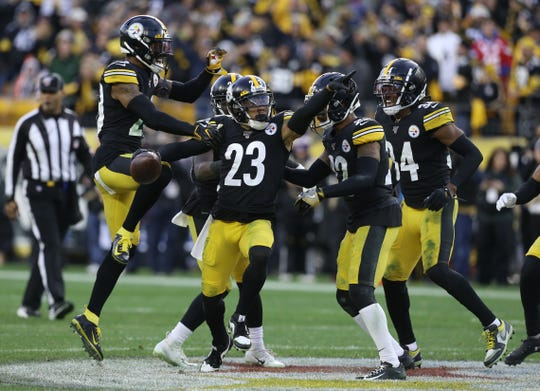 Pittsburgh Steelers cornerback Joe Haden (23) celebrates with defensive teammates after a game clinching interception against the Cleveland Browns during the fourth quarter at Heinz Field. The Steelers won 20-13.