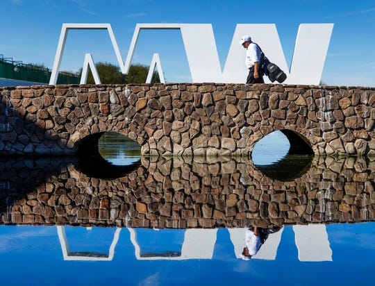 A caddie crosses the bridge after leaving the 15th hole during the Kadima.Ventures Pro-Am at the Waste Management Phoenix Open at the TPC Scottsdale, Monday, January 28, 2019.