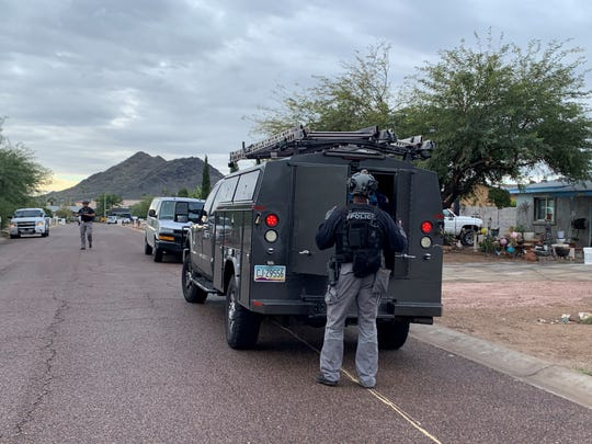 A SWAT team assists Phoenix police in a search for a man on 22nd Street between Larkspur Drive and Sahuaro Road in Phoenix, Wednesday, Dec. 4, 2019.
