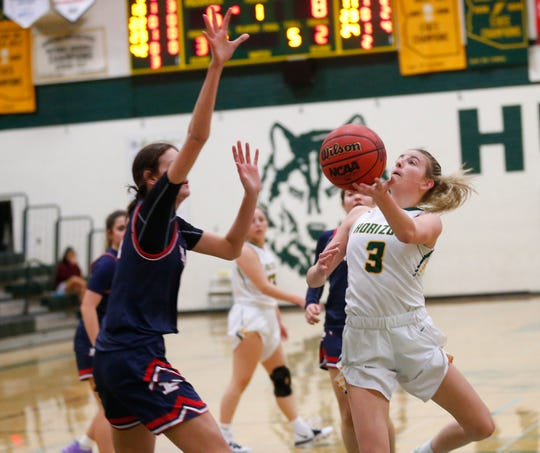 Horizon's Sedona Anderson (3) puts a shot up while challenged by Pinnacle's Kennedy Basham (11) during the first half in Scottsdale December 3, 2019.