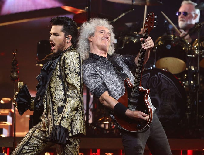 Adam Lambert, Brian May and Roger Taylor of Queen + Adam Lambert perform during their Rhapsody Tour at Talking Stick Resort Arena on July 16, 2019, in Phoenix.
