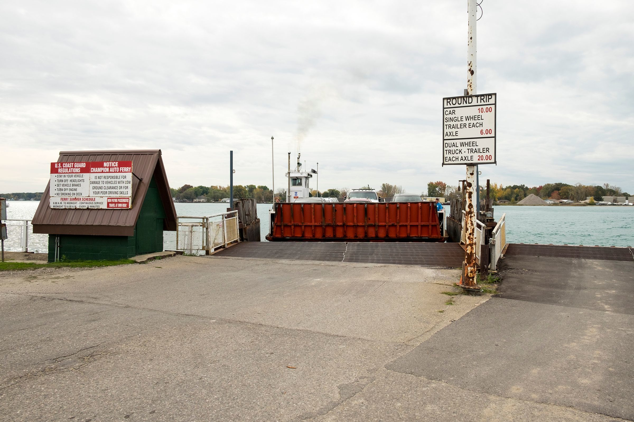 Champion's Auto Ferry pulls up to the dock in Clay Township to unload vehicles from Harsens Island Oct. 23, 2017.