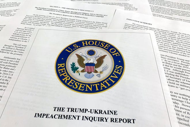 The report from Democrats on the House Intelligence Committee on the impeachment inquiry into President Donald Trump is photographed in Washington, Tuesday, Dec. 3, 2019. The House released a sweeping impeachment report outlining evidence of what it calls Trump's wrongdoing toward Ukraine. The findings will serve as the foundation for debate over whether the 45th president should be removed from office. (AP Photo/Jon Elswick)