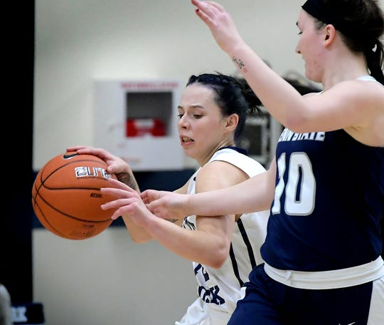 Penn State York's Sky Warner, left, moves the ball with pressure from Penn State Schuylkill's Carly Teaschenko during basketball action at the York campus Tuesday, Dec. 3, 2019. Bill Kalina photo