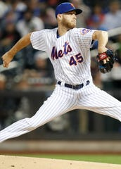 FILE - In this Sept. 15, 2019, file photo, New York Mets starting pitcher Zack Wheeler (45) winds up during the first inning of a baseball game against the Los Angeles Dodgers, in New York. Two people familiar with the deal say the Philadelphia Phillies and right-hander Zack Wheeler have agreed on a five-year, $118 million contract. Both people spoke to The Associated Press on condition of anonymity Wednesday, Dec. 4, 2019, because they weren't authorized to announce the signing. (AP Photo/Kathy Willens, File)