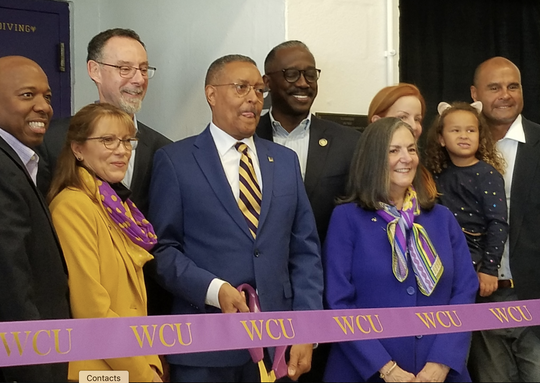 Ronn Jenkins shown in the middle at the ribbon cutting ceremony for the pool dedication ceremony at West Chester University