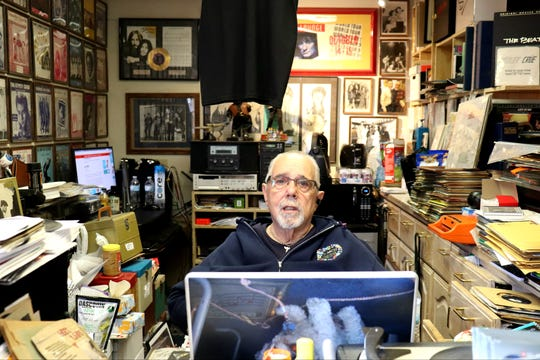 Rich Rosen, of Wax Trax Records, in his happy place. He spends seven days a week sitting at the counter of Wax Trax Records.