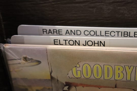 Elton John has bought his own records at Wax Trax.