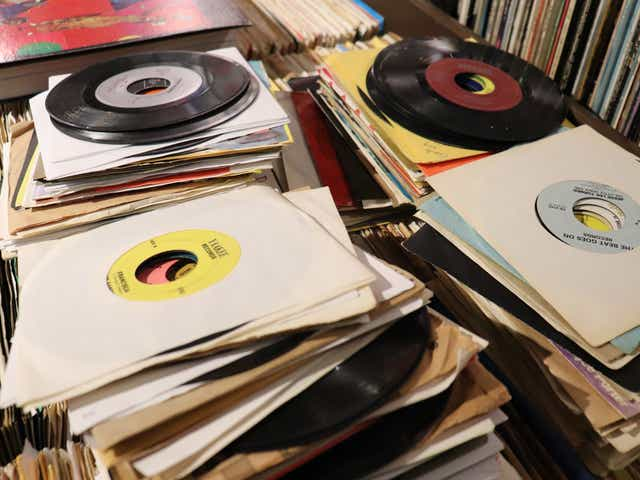 Image result for records piled up