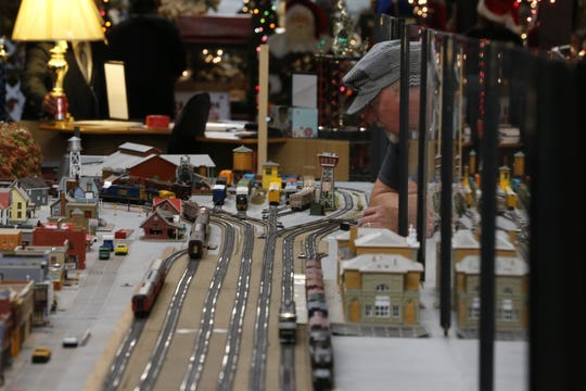 Greg White checks the model train display Tuesday during the Old-Fashioned Community Christmas Festival.