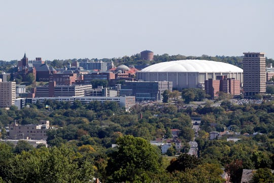 FILE - This Sept. 21, 2015, file photo, shows The Carrier Dome at Syracuse University in Syracuse, N.Y. Syracuse University students describe fear and anxiety as reports of racist graffiti and vandalism add up.