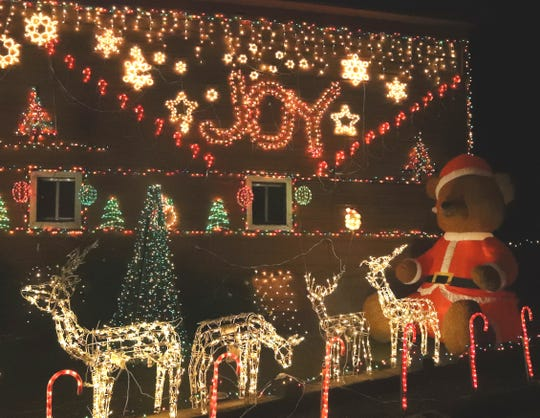 Christmas lights adorn the barn owned by Richard and Fran Wilkinson at 3187 Barrel Court in south Redding.