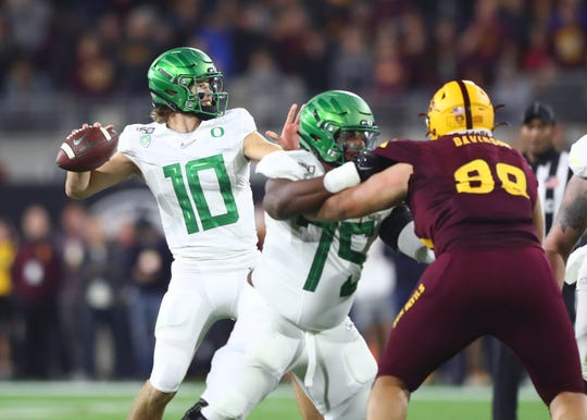 Nov 23, 2019; Tempe, AZ, USA; Oregon Ducks quarterback Justin Herbert against the Arizona State Sun Devils at Sun Devil Stadium. Mandatory Credit: Mark J. Rebilas-USA TODAY Sports